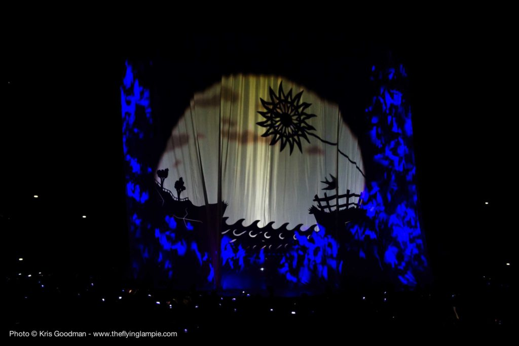Shadow theatre of a boat on the water projected on large curtains at the SSE Hydro Arena Glasgow